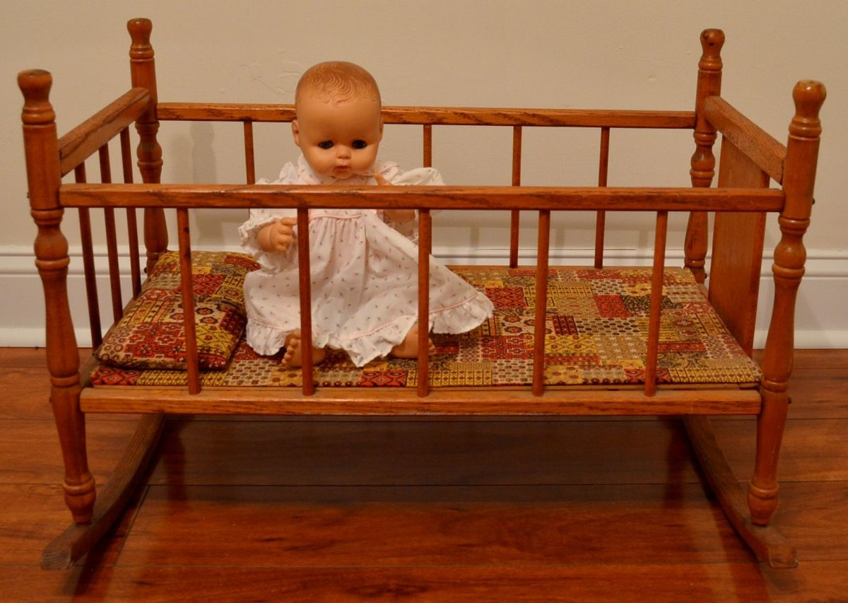 """Nancy"" in my doll cradle."