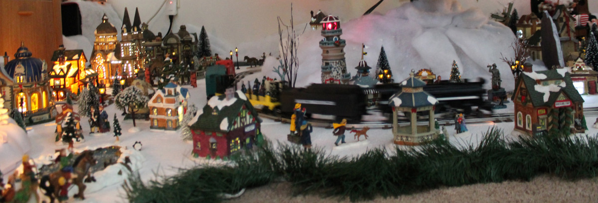 A model train display within a snow covered village.
