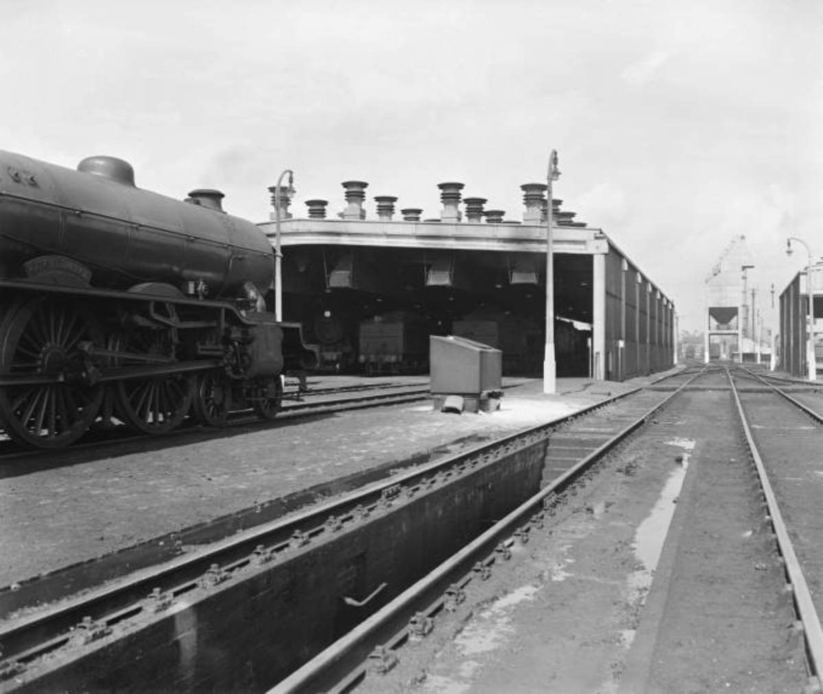 Looking along the more modern Ipswich straight shed (former GER area) towards the coaler in 1958. LNER Gresley-designed Class B17 'Sandringham' class to the left