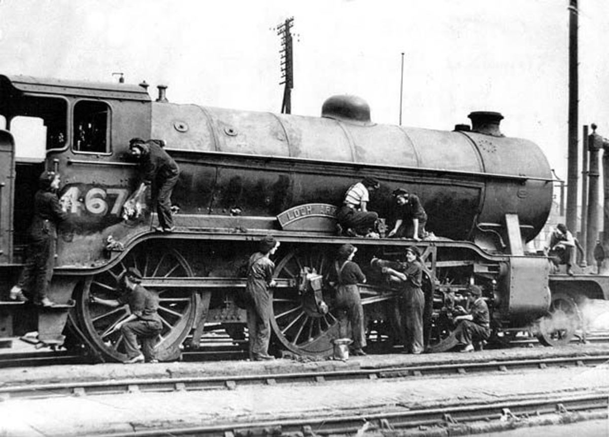 St Margaret's shed, Edinburgh with wartime (WWII) cleaners hard at work - most of the male staff had either volunteered for or were called up on military service. The engine is one of the Scottish LNER Class K2