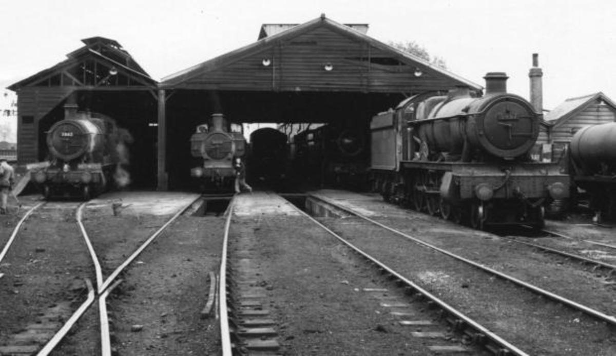 Western this time, at Oxford mpd with ex-GWR classes in evidence outside the dilapidated, although still standing shed. Locomotives stand over ash-pits in this view