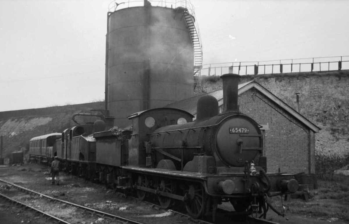 North-eastward out of London was Hitchin's small mpd - Her days numbered, former GER Class J15 0-6-0 designed by T W Worsdell before he joined the NER poses on one of the back roads in 1959
