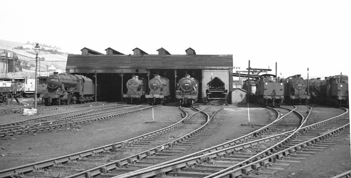 LMS area again, this time at the much smaller former Midland Railway Buxton mpd (8D) in Derbyshire with several locomotives poking out of the early 'northlight' shed.