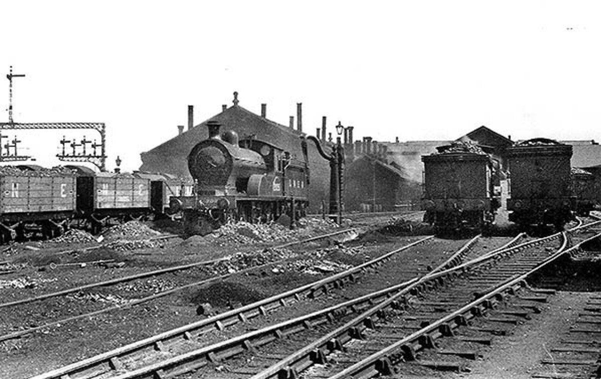 Tweedmouth shed displays its NER credentials in 1936 (LNER days) with a handsome NER Class R (LNER D20) 4-4-0 centre stage by one of the watering cranes; on the right are three more ex-NER tender classes 'looking' away from the camera
