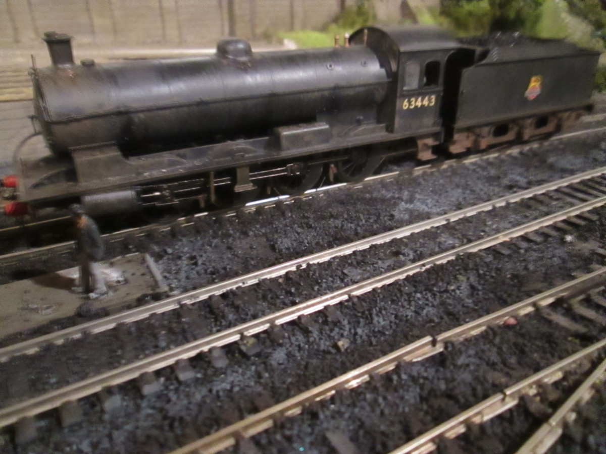 A touch of local NER colour, (Hornby) Q6 63443 rests on the loco coaler road at Ayton Lane between duties