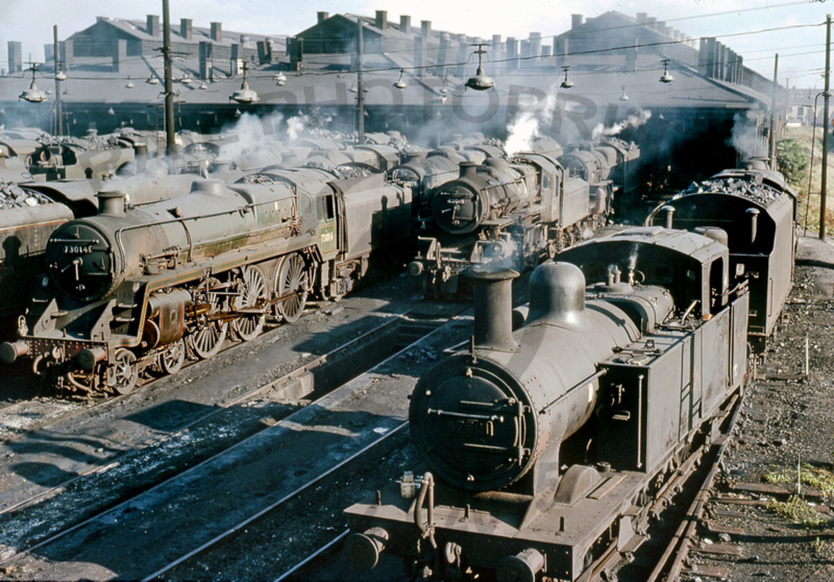 A BR Midland Region in the final days of steam - the nearest loco, an 0-6-0 'Jinty' tank loco has seen better days, with younger Ivatt 2-6-0 and BR Standard Class 5 4-6-0 to her right