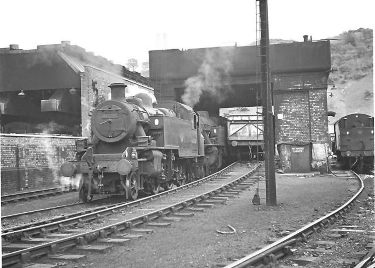 Bangor mpd, North Wales. services to holiday resorts dominated traffic. Here's one of the passenger tank loco fleet, 41200 resting between shifts