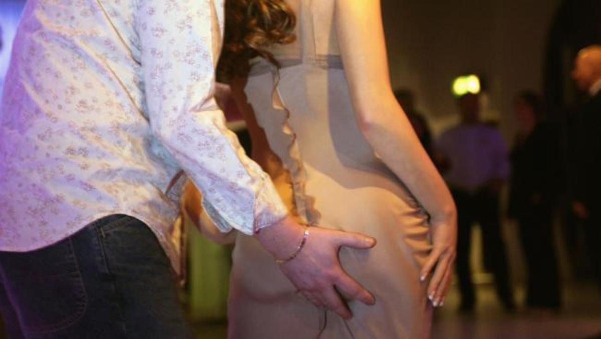 Don't ever grab or intentionally touch a woman's breasts, butt, or other personal area while dancing together. It's very rude and inappropriate.