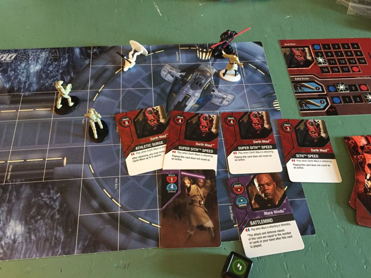 Gameboard with miniatures and sample cards