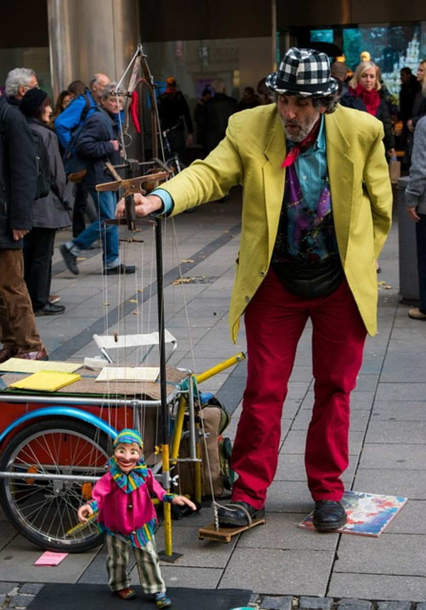 A street puppeteer working his marionette.