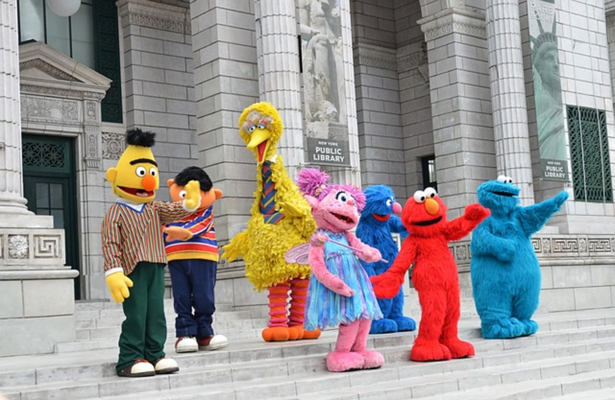 Universal Studios, Singapore, with a group shot of characters at Sesame Street Theme Park.