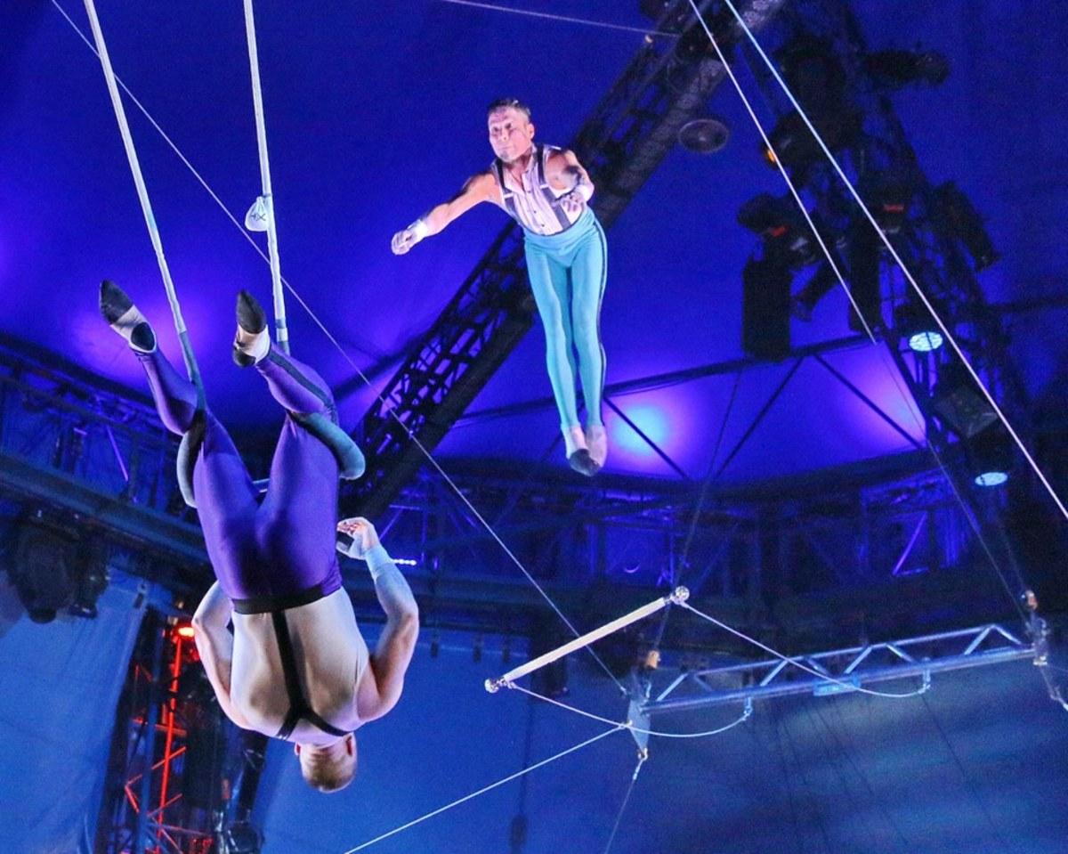 Trapeze Flyer Mauricio Navas reaches his catcher, Adriano de Quadra; Big Apple Circus
