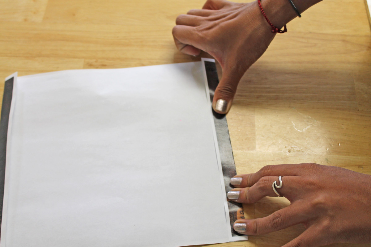 Fold the top and bottom and run your fingers along the fold to give it a good crease.