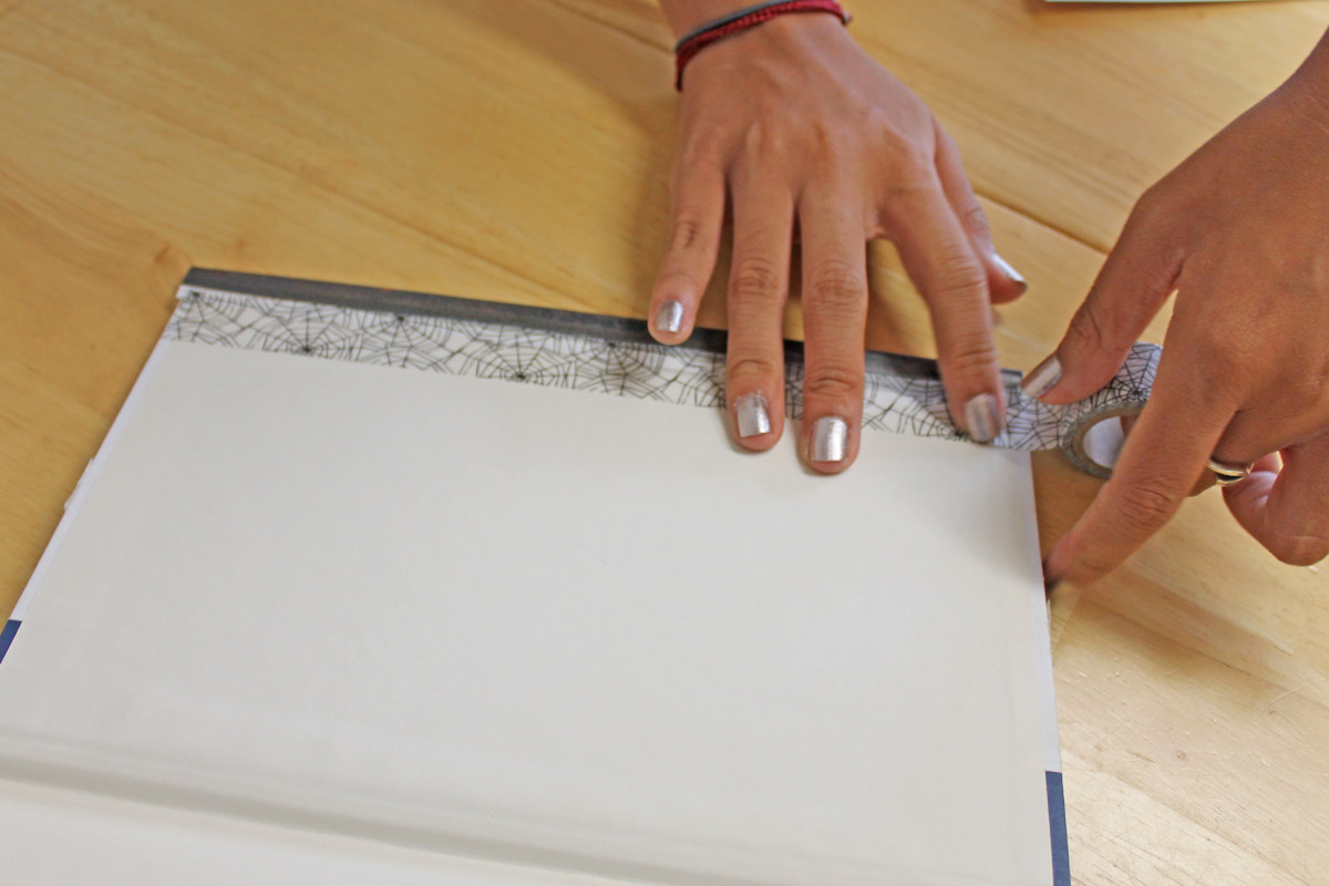 Place the washi or masking tape along the inside cover and trim the edges with scissors.