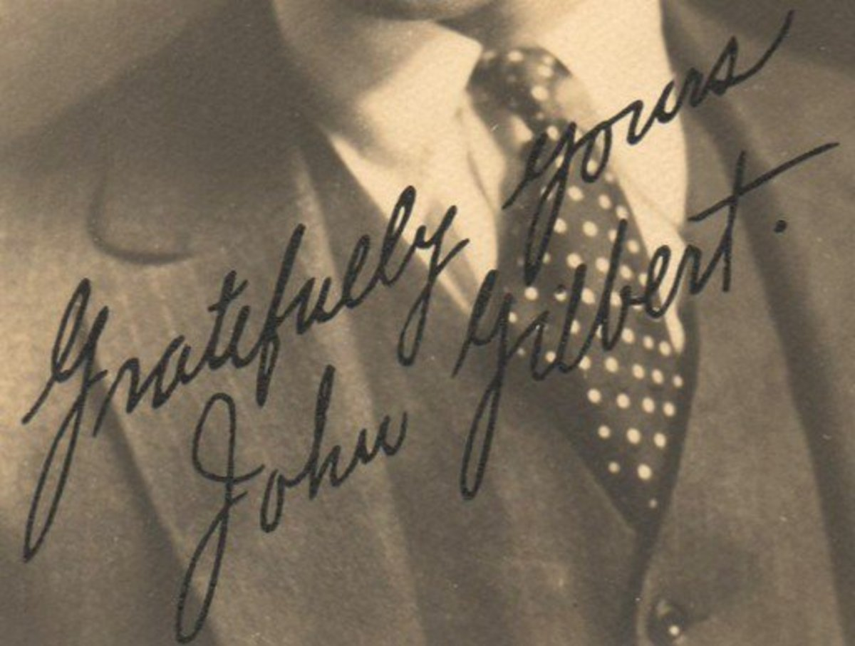 Rubber-stamped autograph of silent film star John Gilbert, one-time fiance of actress Greta Garbo..  Notice the dot after his last name.   Author's collection
