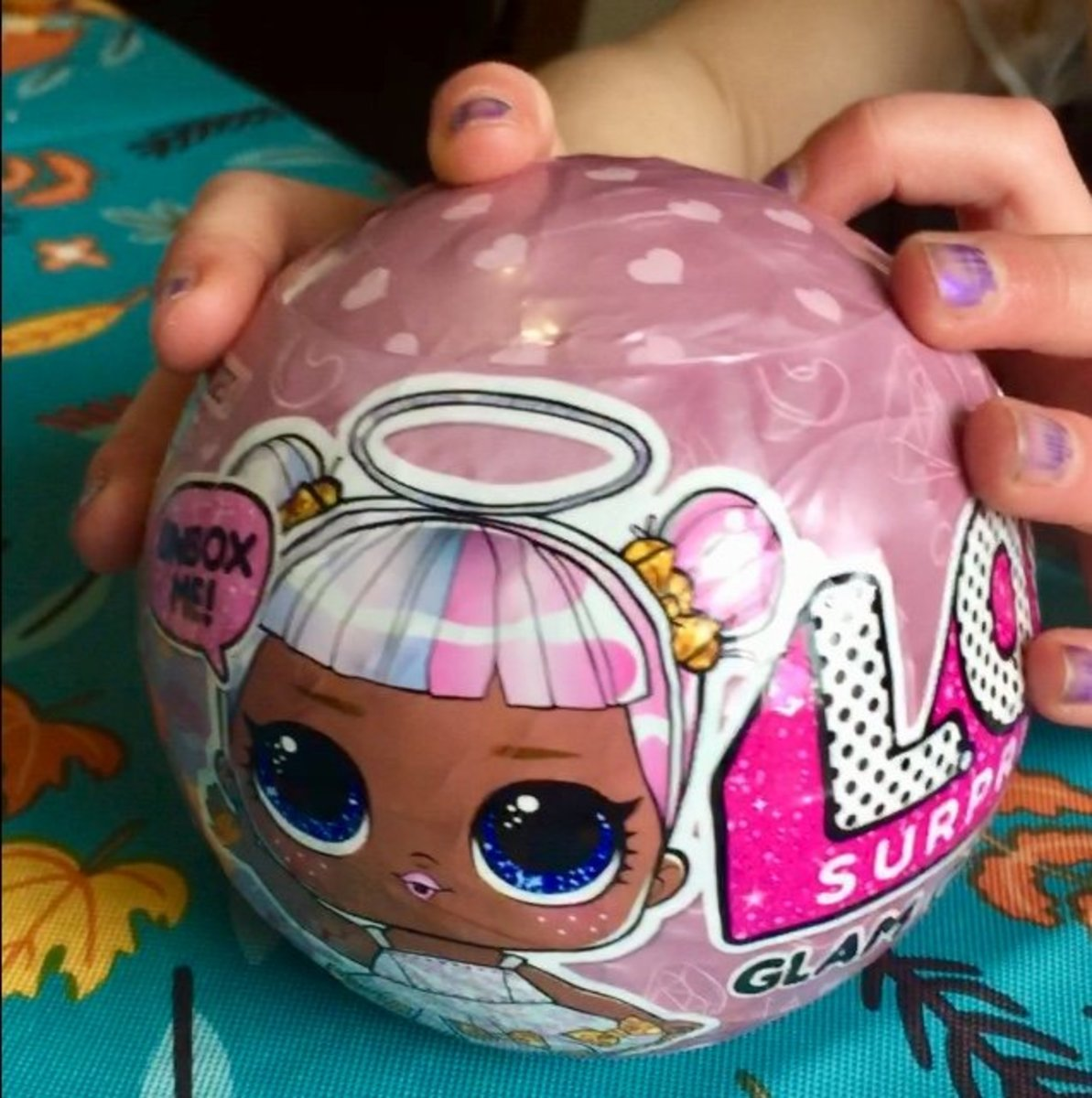 The thrill of unraveling a mystery contributes to the addicting nature of these L.O.L. dolls.
