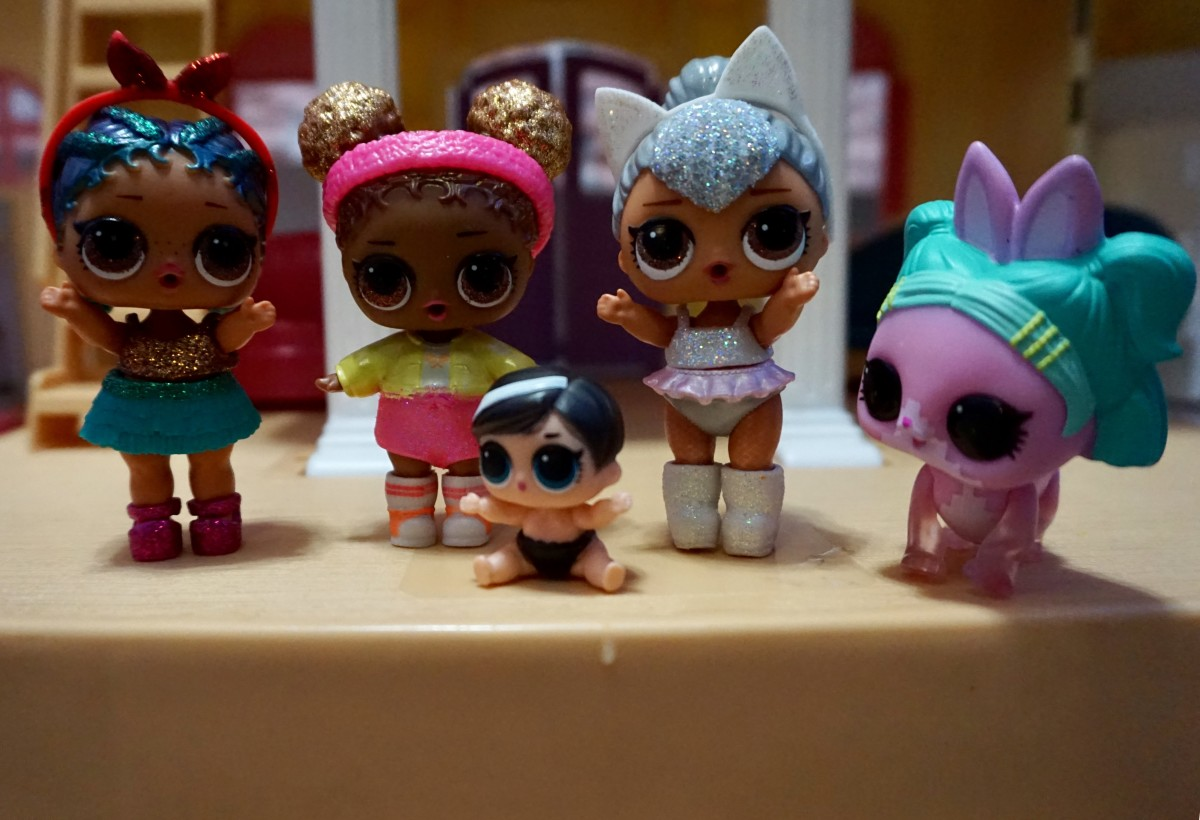 My daughter's L.O.L. collection from left to right: the singer, the basketball player, baby sister, the ballerina, and their beloved pet dog