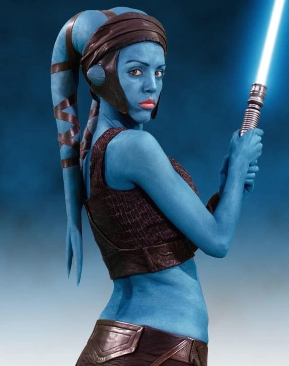 Aayla Secura wielding her blue lightsaber.