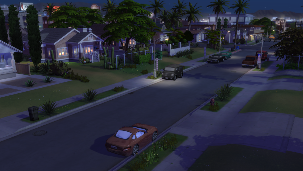 The Sims 4 has cars, but only as decoration.  The Get Famous expansion pack features lots of cars parked on the side of the road (pictured above), but you can't interact with them.