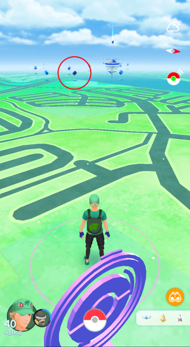 An invaded Pokestop in the background