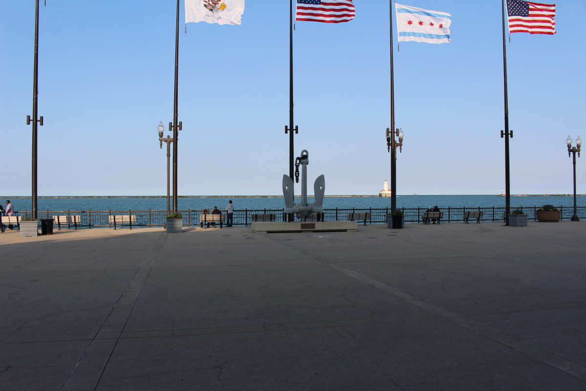 Flag poles around the anchor of the USS Chicago. Navy Pier was a training ground and base, for the United States Navy, from 1941-1946.