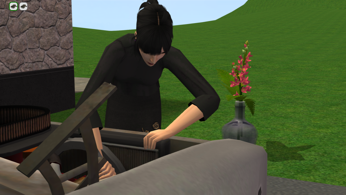 My Sim working on a car, with a snapdragon in the background.