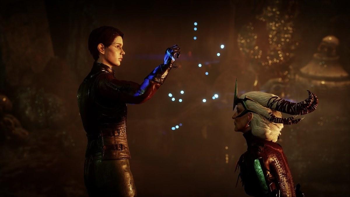 Flemeth takes the dragon soul from Kieran.