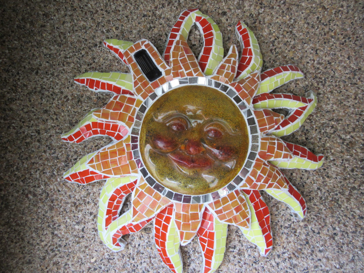 Using a glass mosaic technique on a common plastic piece adds richness to this solar light fixture.