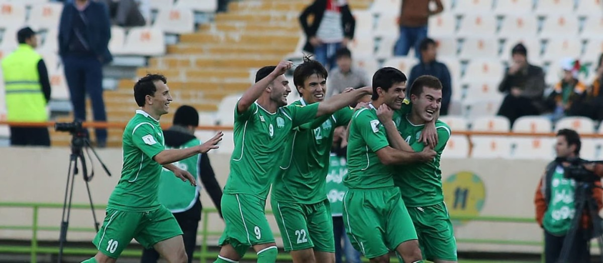 Turkmenistan players celebrate following a goal during a 2018 World Cup qualifier against IR Iran in Dasoguz, Turkmenistan in June 2015.