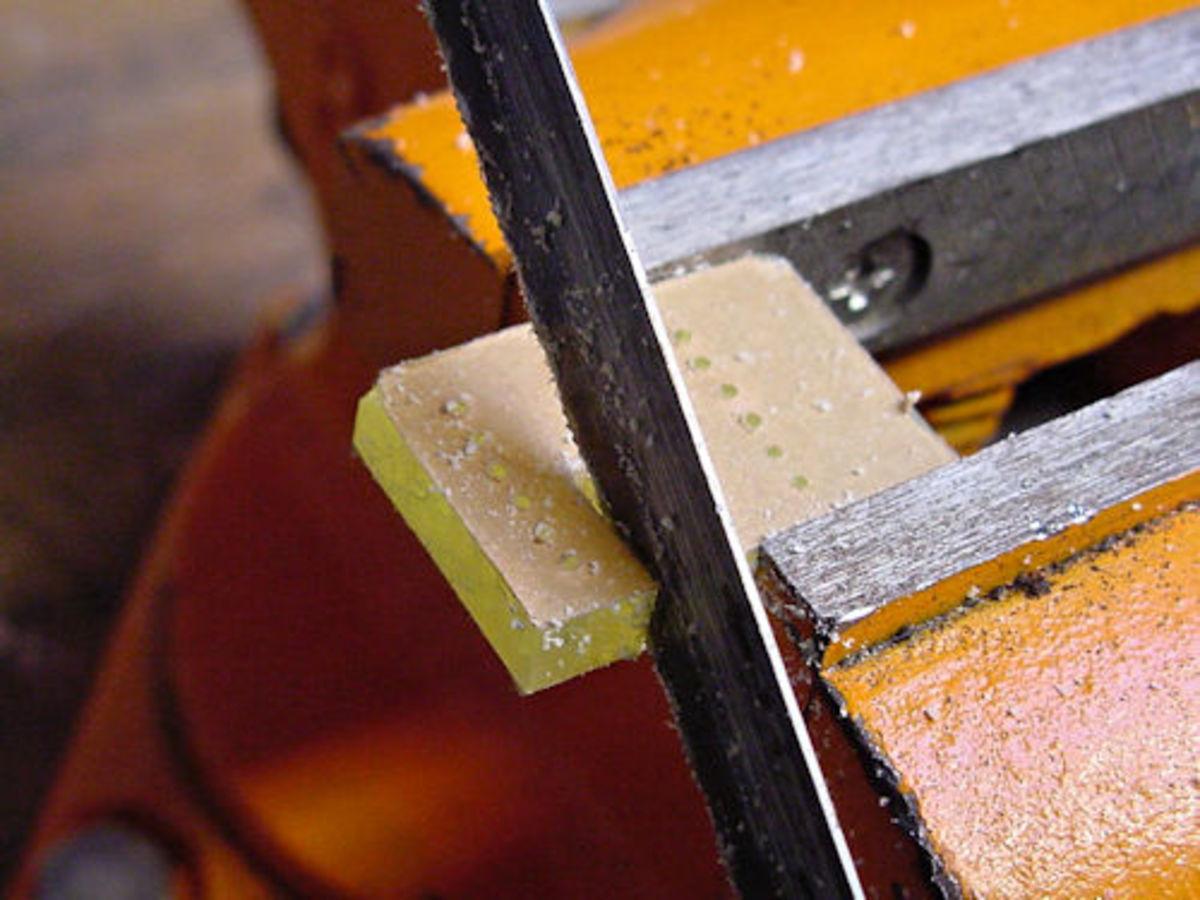 Cutting acrylic with a hacksaw.