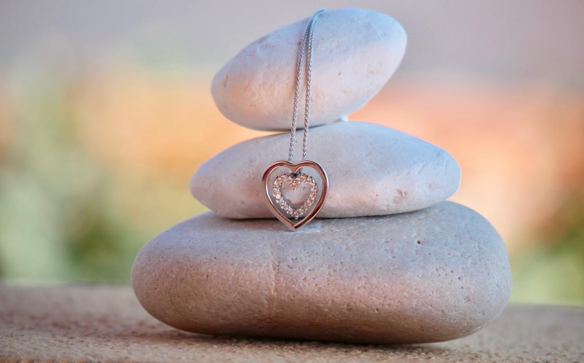 Diamond heart necklace on stones