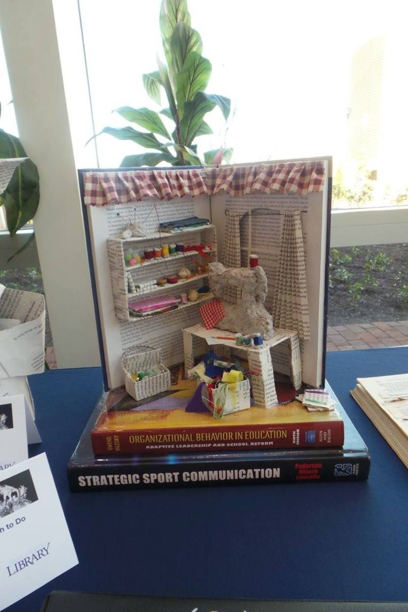 Book sculpture with miniature sewing notations