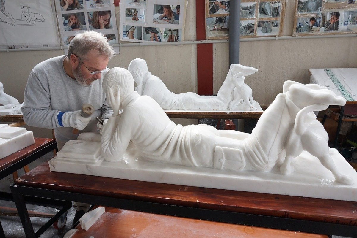 John Wall is busy working on a marble statue. Working with marble is for the more advanced sculptor.