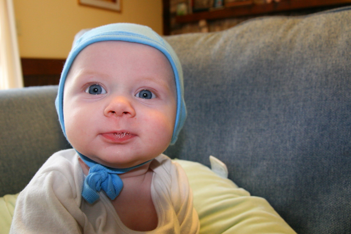 Our son started wearing his hearing technology at the age of four months. We found a pilot cap to be vital when he was an infant, as it kept his hearing technology in place.