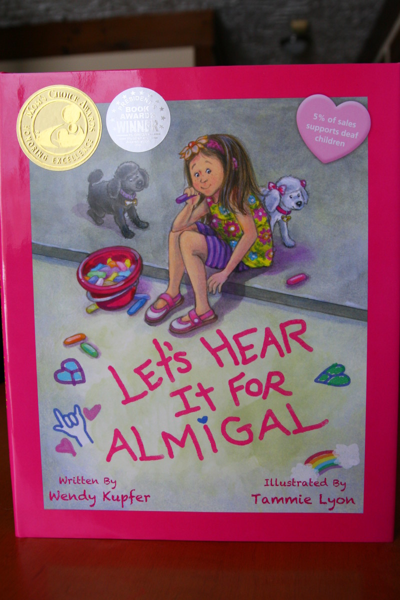 "Let's Hear It for Almigal is a fun, sweet story about a little girl who wants to hear the birds chirping and her friend's ""teeny tiny voice."""