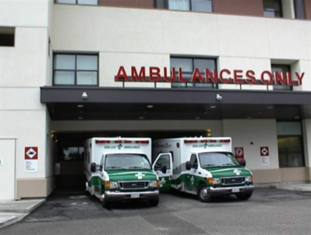 I took this picture of ambulances unloading patients at Twin Cities Hospital  last summer, long before either of us had heart symptoms.