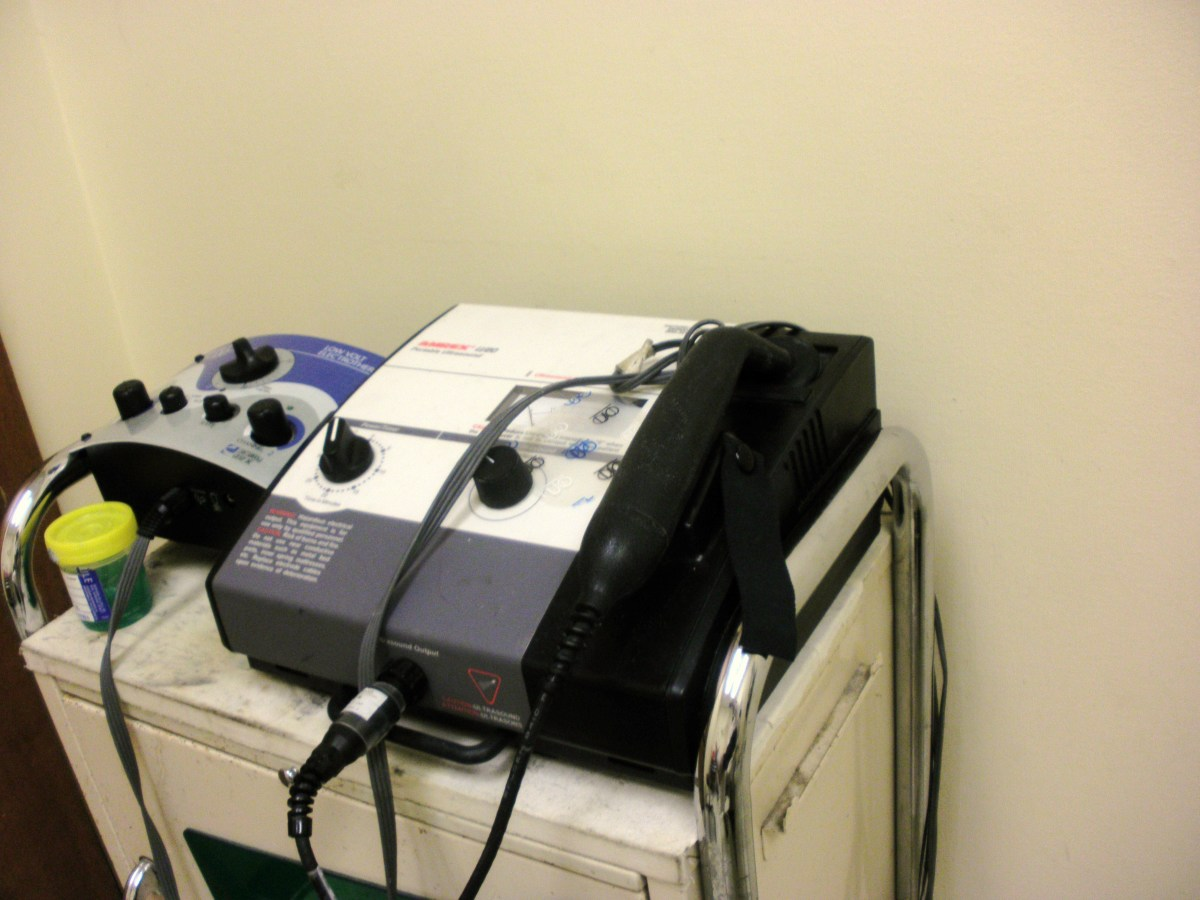 The machine on the right provides ultrasound therapy for foot pain. The one on the left is for electrostim therapy.