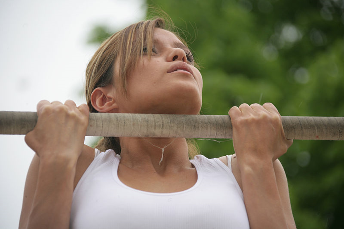 Strong woman doing pull up