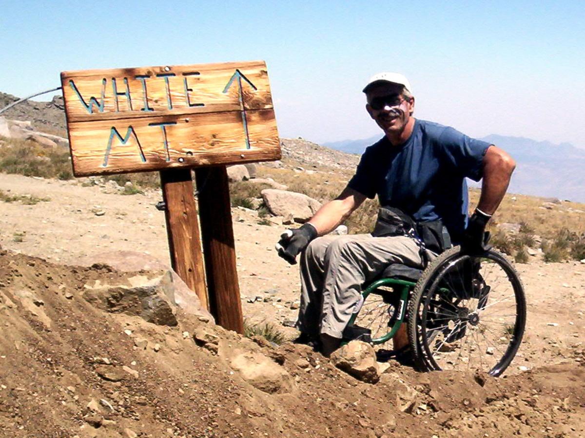 Man wheelchair hiking