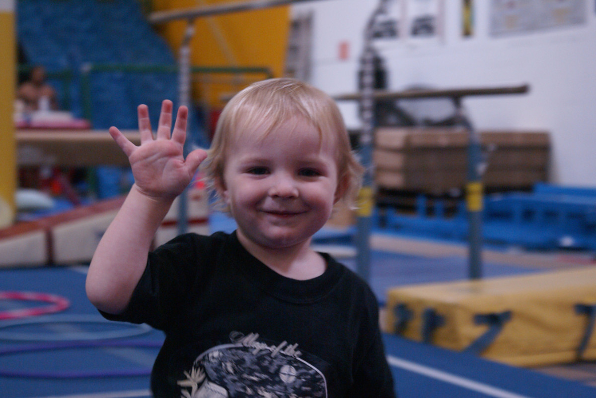 Child waving goodbye