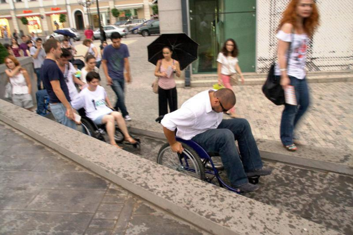 Climbing hill in wheelchair