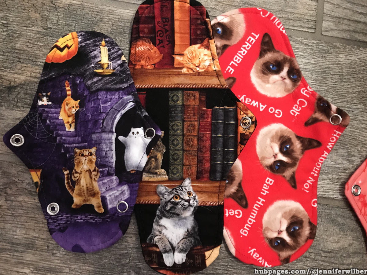 "Party in My Pants cloth pads - thong liner in ""Scaredy Cat,"" medium pad in ""Cat's Cradle,"" and luxe liner in ""Silent Majority."" You won't be a grumpy cat with these pads!"