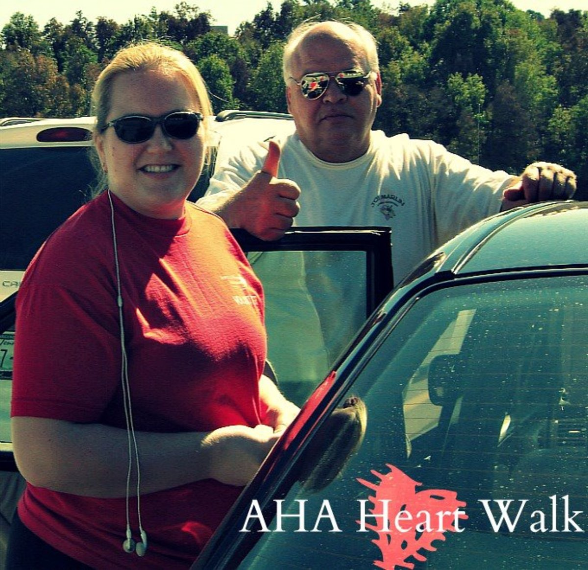 This is a photo of my dad and I at our first AHA Heart Walk.