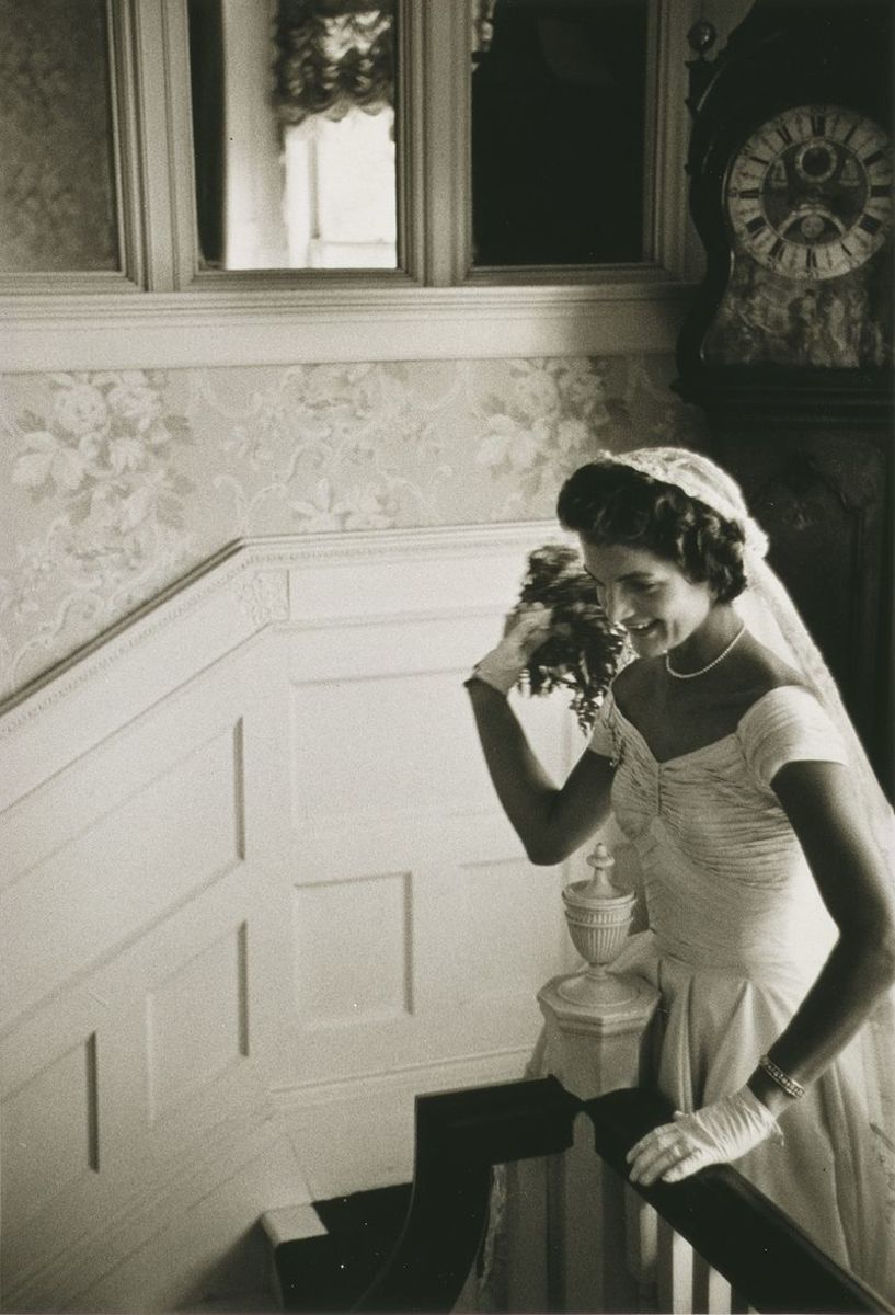 Jacqueline Kennedy at her 1953 wedding to John F. Kennedy. Jackie is throwing the bouquet. This photo was taken on September 12, 1953.