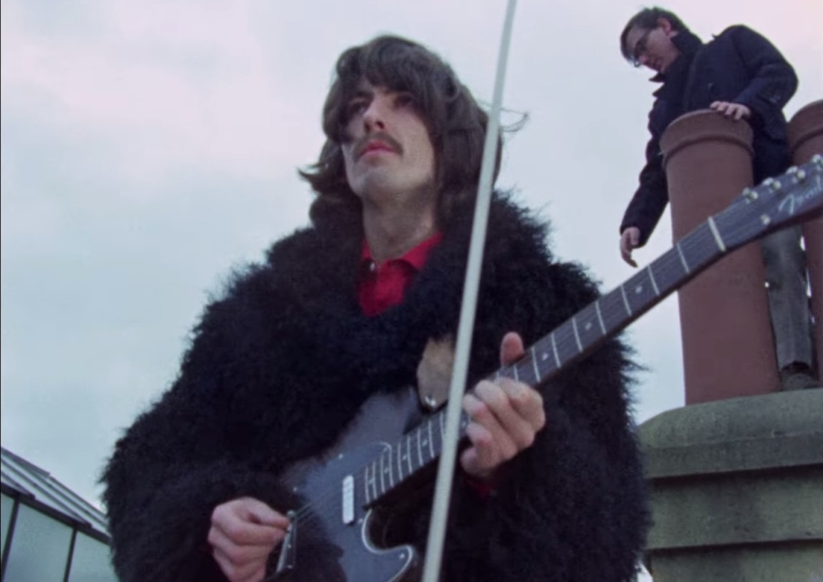 George Harrison with his rosewood Fender Telecaster on a rooftop for Let It Be.