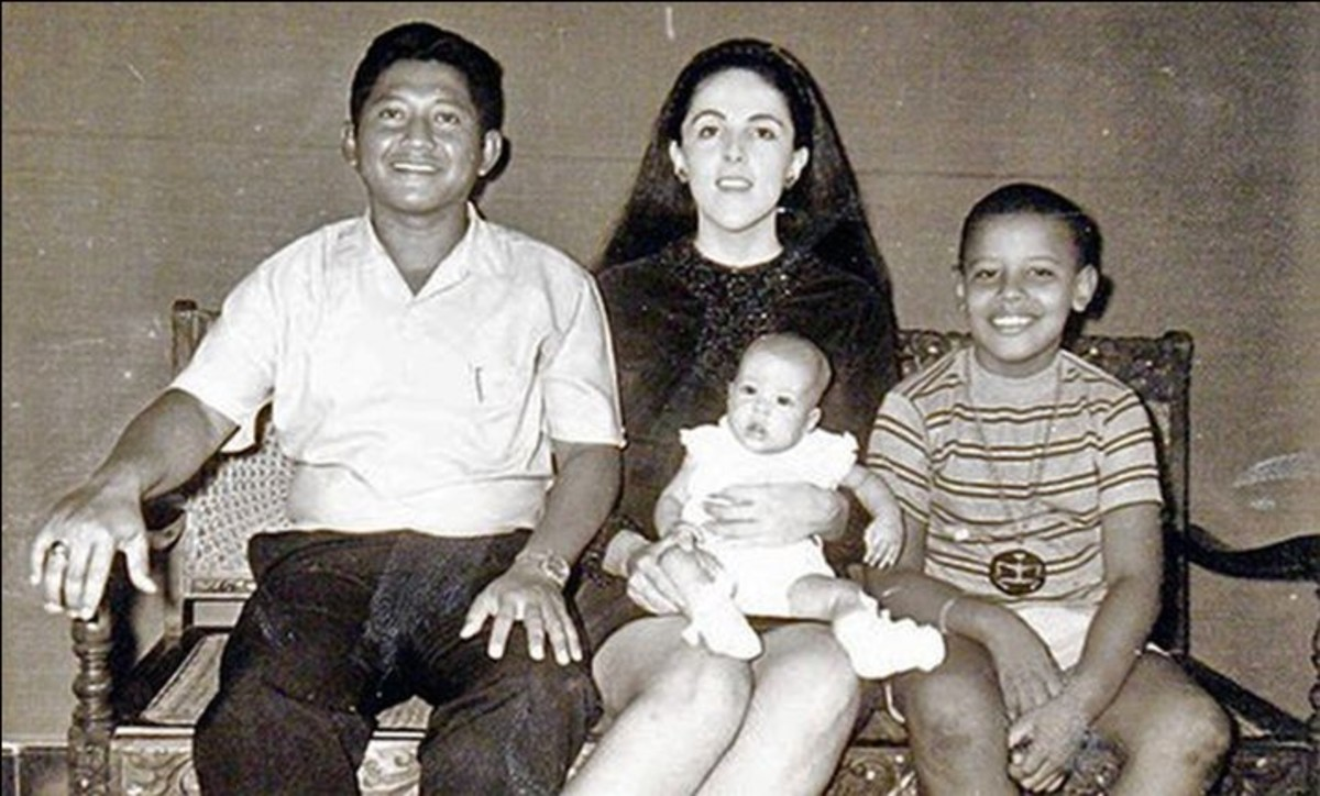 Barack Obama with his stepfather, mother and half sister.
