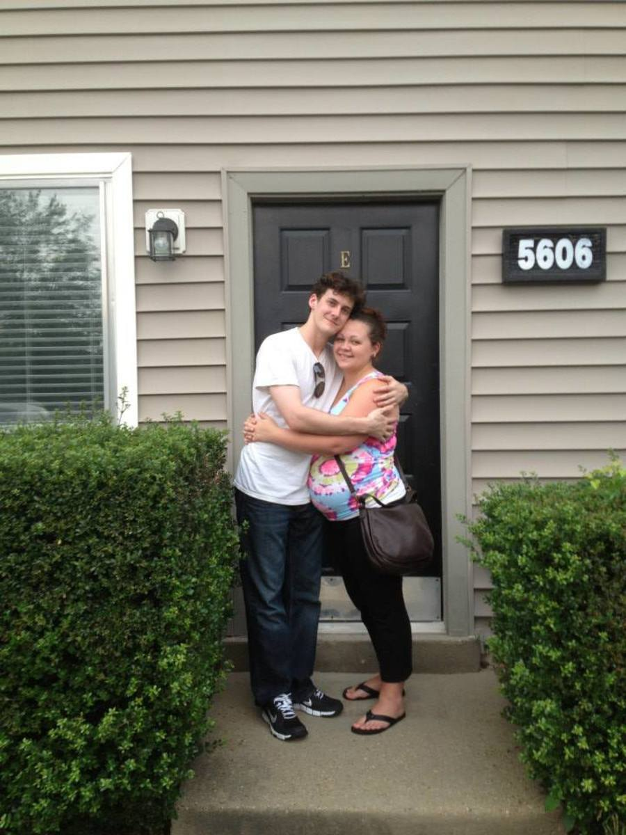 Our first apartment together. 8 months pregnant. (2013)