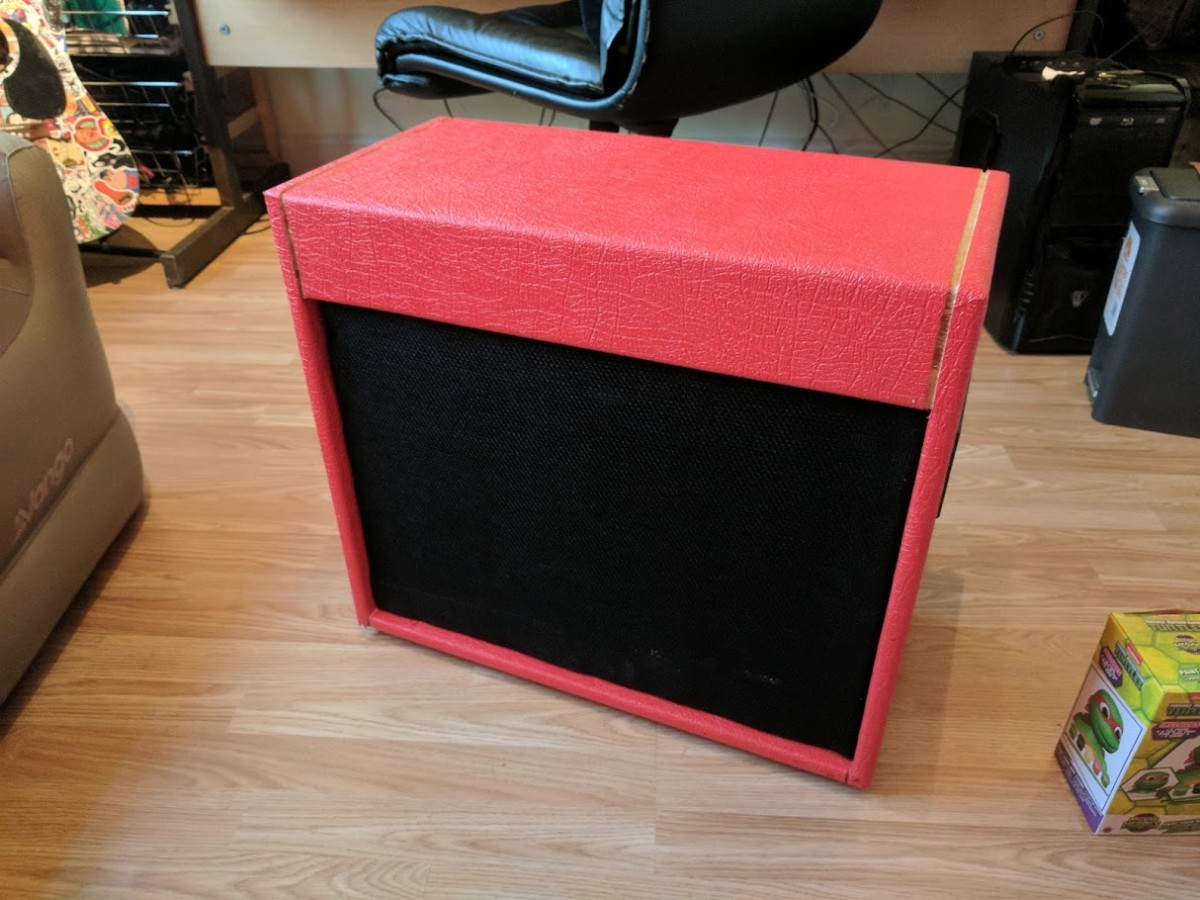 My own DIY guitar cab (not 100% finished here). A 1x12 cab wrapped in tolex.