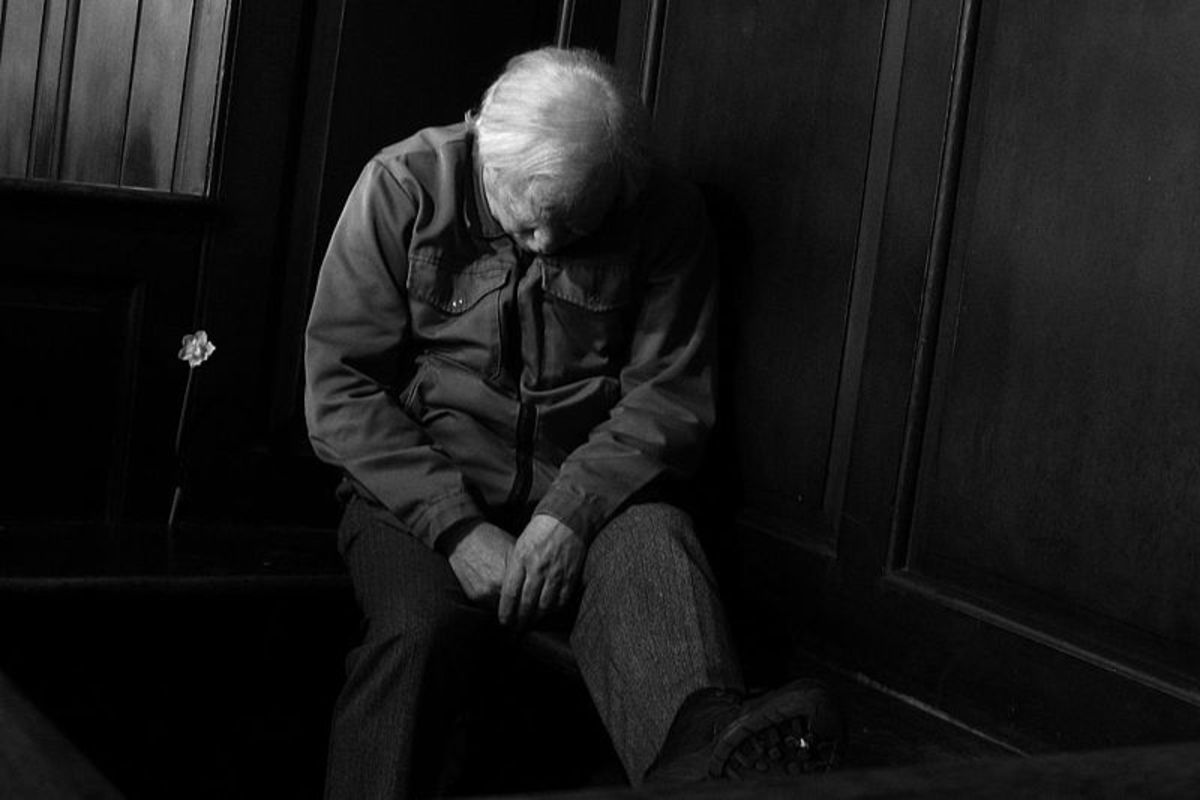Old Man Bowed in Church