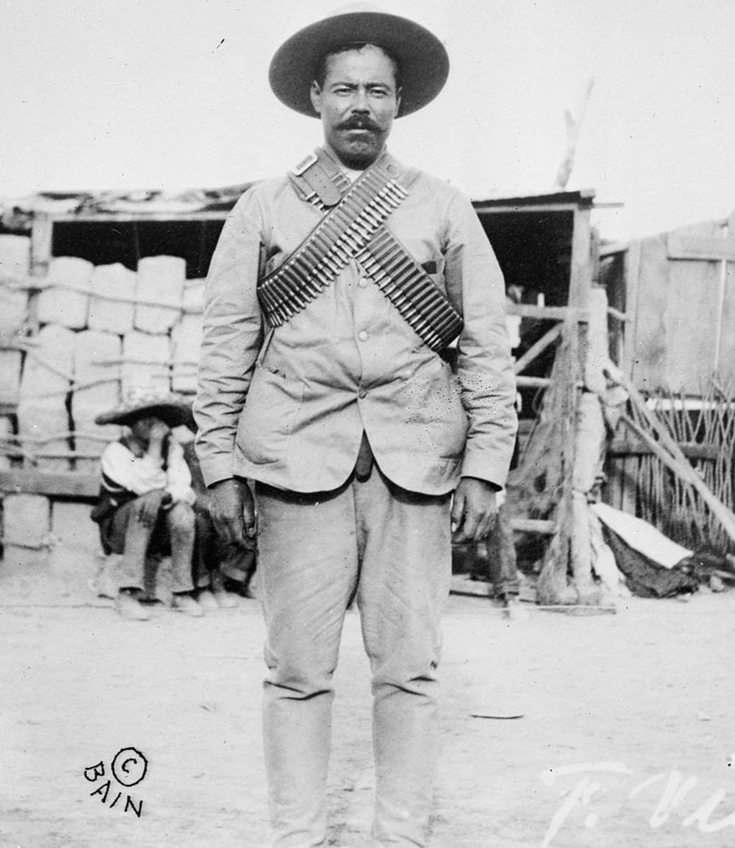 Pancho Villa, Mexican Revolutionary general wearing bandoliers in front of an insurgent camp